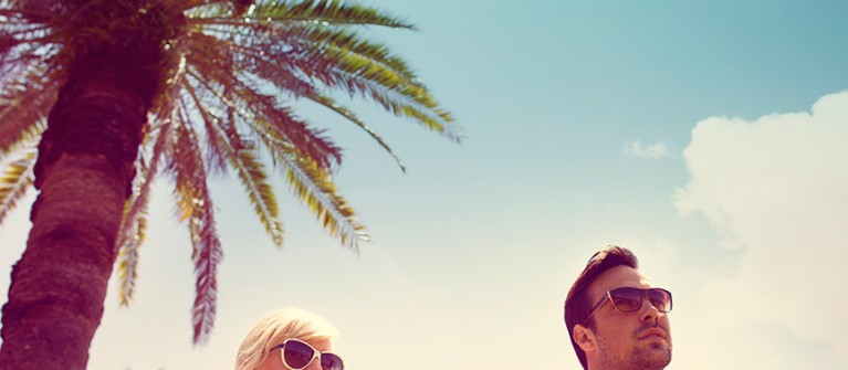 Two people and palm tree