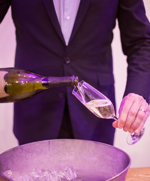 Man pouring glass of champagne